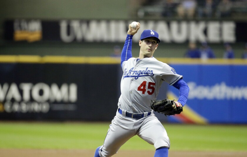 Dodgers starter Joe Wieland throws during the first inning against the Brewers. He allowed five runs in the inning.