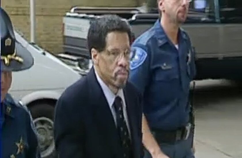 """In this Feb 12, 2015 file photo made from video and released by WBRZ-TV in Baton Rouge, Albert Woodfox walks into a courthouse in Louisiana. Woodfox, the last inmate of a group known as the """"Angola Three"""" has pleaded no contest to manslaughter and a lesser offense in the 1972 death of a prison guar"""