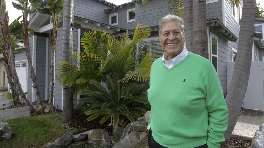 """Brian Wofford, 68, outside his Encinitas home, which was dramatically tansformed 15 years ago on the ABC TV series """"Extreme Makeover: Home Edition."""""""