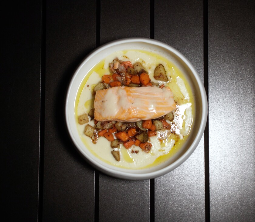 A photo of salmon dinner from Luca at The Guild Hotel