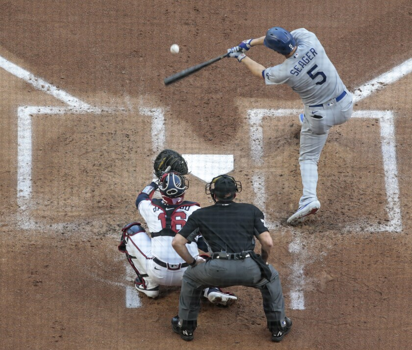 Corey Seager hits an RBI single in the first inning of Game 3.