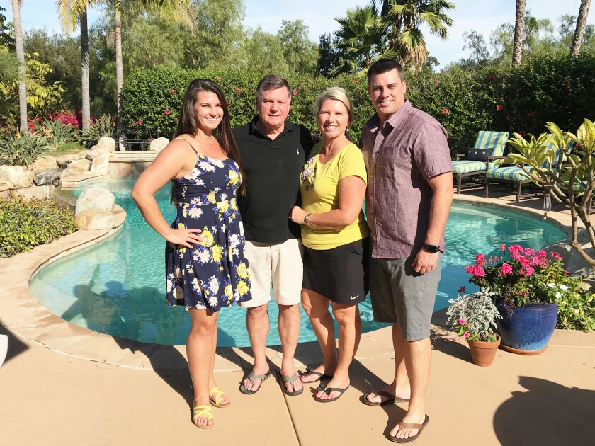 The Robling family — Kim, Terry, Cathe and John — at their home in Poway.