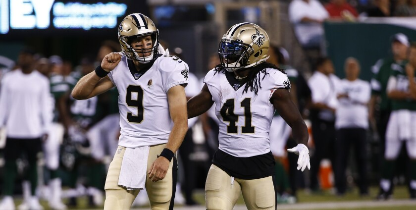 Saints quarterback Drew Brees, left, and running back Alvin Kamara celebrate a touchdown on