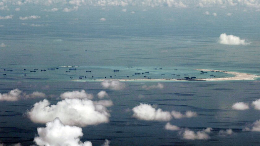 China has expanded small land formations it controls in the South China Sea, piling sand onto outcroppings and building landing strips. The land reclamation of Mischief Reef in the Spratly Islands is seen here in 2015.