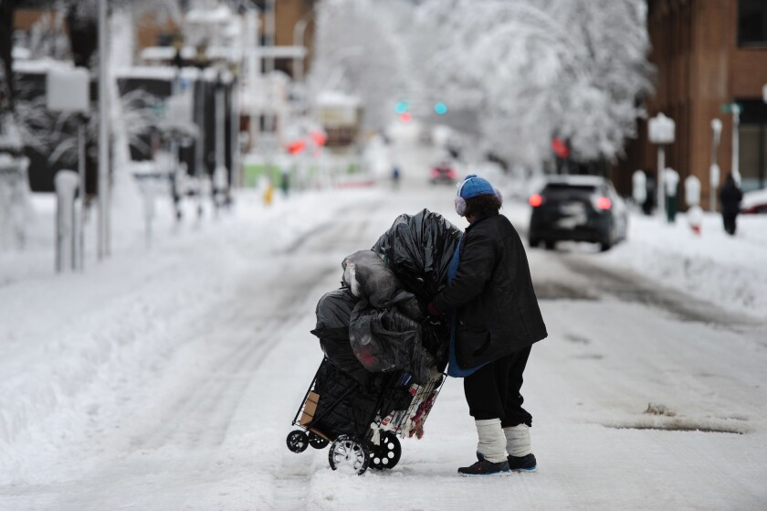 A homeless woman in Portland, Ore., where an extreme cold spell has killed at least four homeless people this month.