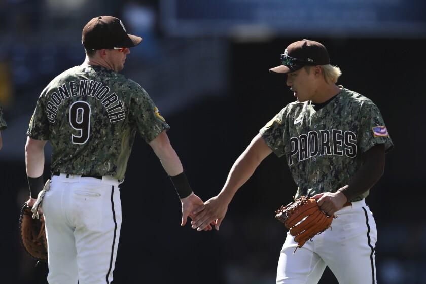 The Padres' Jake Cronenworth (9) celebrates with Ha-Seong Kim