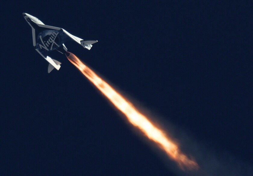 Virgin Galactic's SpaceShipTwo fires its rocket engine during a test flight.