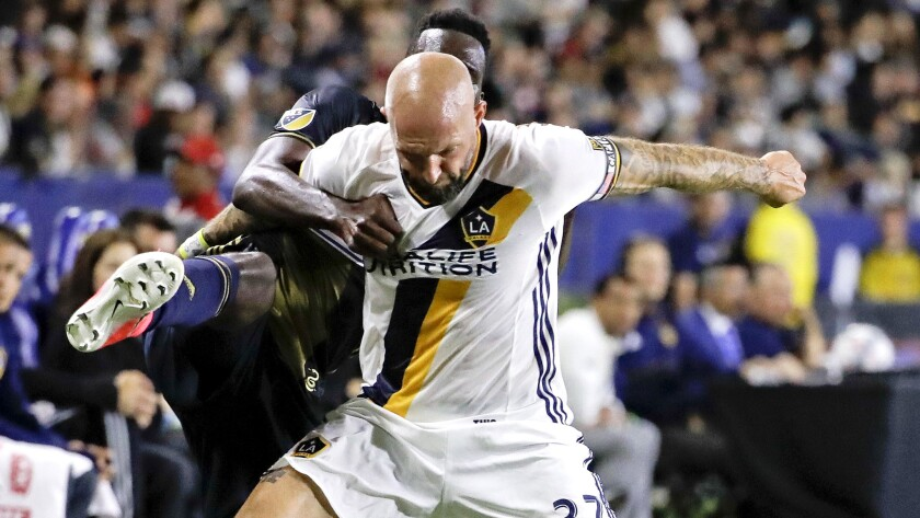 LA Galaxy defender Jelle Van Damme, right, battles Philadelphia Union forward C.J. Sapong for the ba