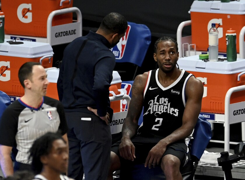 Los Angeles Clippers' Kawhi Leonard sits on the bench after suffering an injury during the second half against the Boston Celtics in an NBA basketball game Friday, Feb. 5, 2021, in Los Angeles. (Keith Birmingham/The Orange County Register via AP)