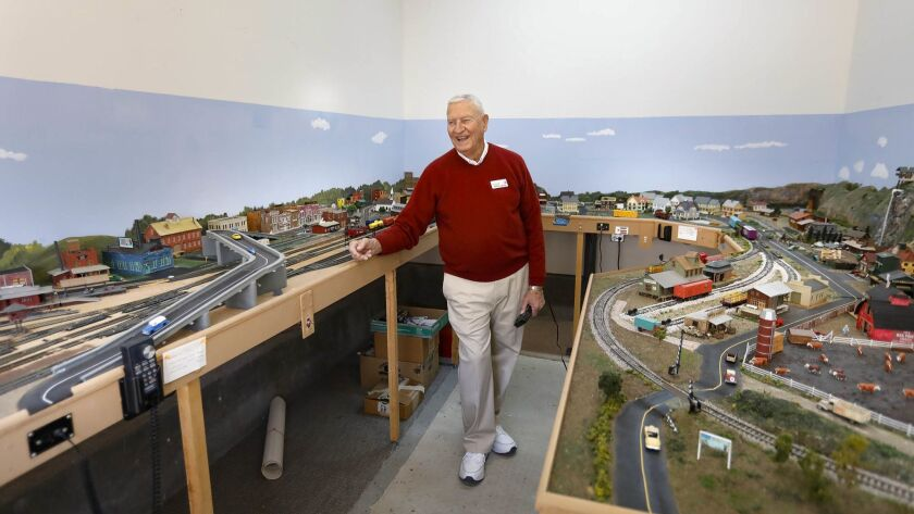 Ron Ludwig, 82, demonstrates just one the HO scale electric model railroad train layouts he has built at the La Costa Glen retirement community in Carlsbad.