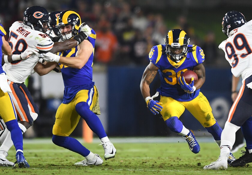 Rams tight end Johnny Mundt, left, helped the offensive line open running lanes for Todd Gurley against the Bears.