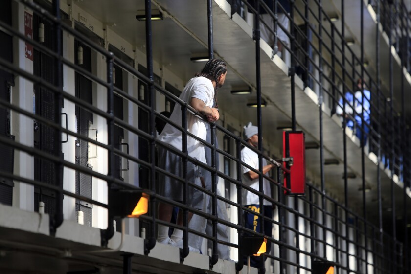 Inmates walk around in one of the cellblocks at San Quentin State Prison in 2014. One inmate at the prison was diagnosed with Legionnaires' disease and several others are showing symptoms, prison officials said.