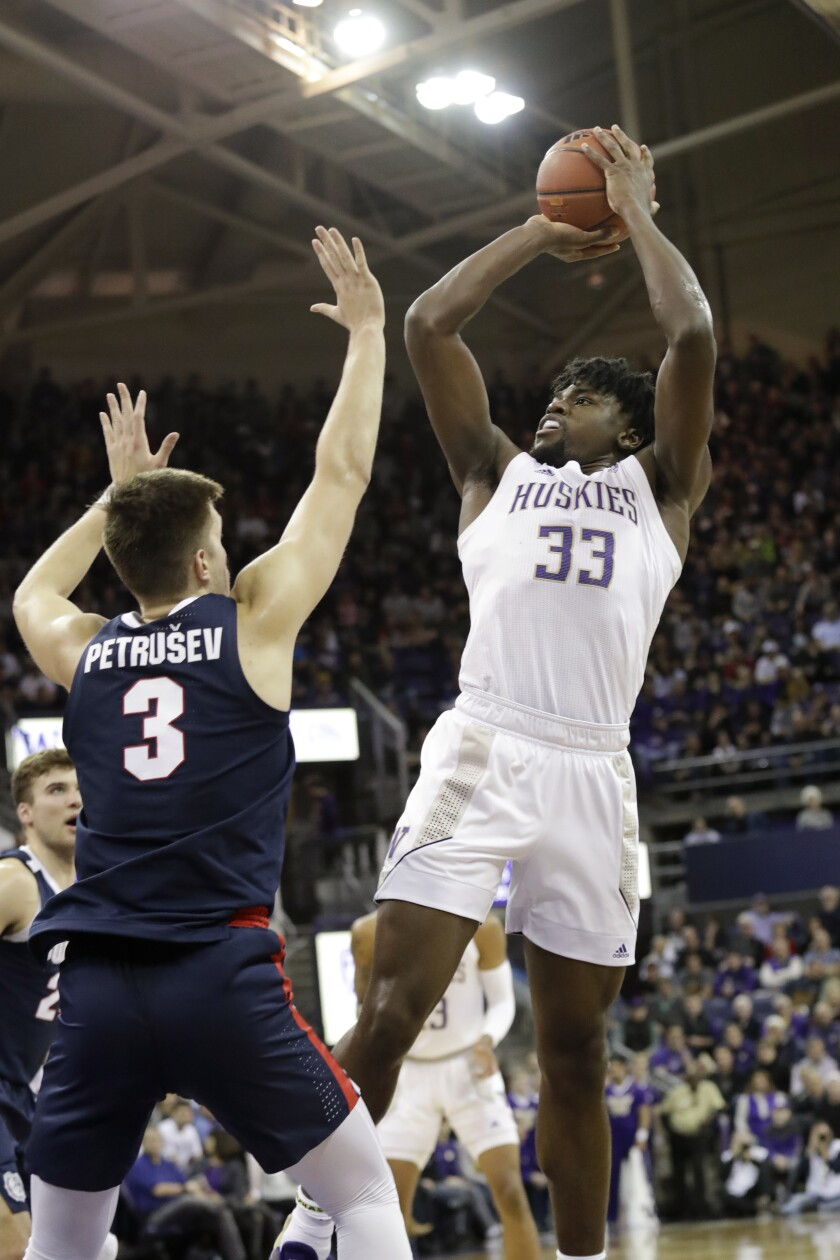 Washington's Isaiah Stewart (33) shoots over Gonzaga's Filip Petrusev (3) in the first half of an NCAA college basketball game Sunday, Dec. 8, 2019, in Seattle. (AP Photo/Elaine Thompson)