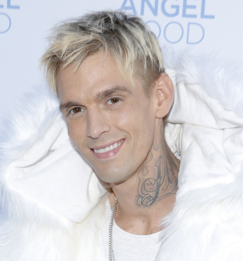 Aaron Carter's face before the new tattoo.