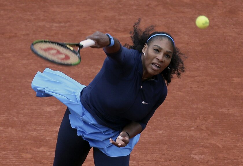Serena Williams of the U.S. serves the ball to Slovakia's Magdalena Rybarikova during their first round of the French Open tennis tournament at the Roland Garros stadium, Tuesday, May 24, 2016 in Paris. (AP Photo/David Vincent)