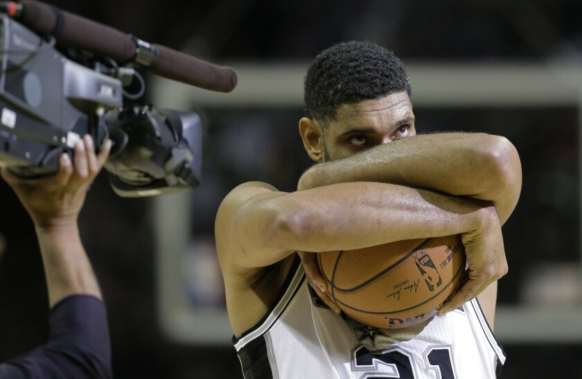 FILE - In this Oct. 28, 2014, file photo, San Antonio Spurs' Tim Duncan prepares for an NBA basketball game against the Dallas Mavericks,in San Antonio. Duncan announced his retirement on Monday, July 11, 2016, after 19 seasons, five championships, two MVP awards and 15 All-Star appearances. It mar