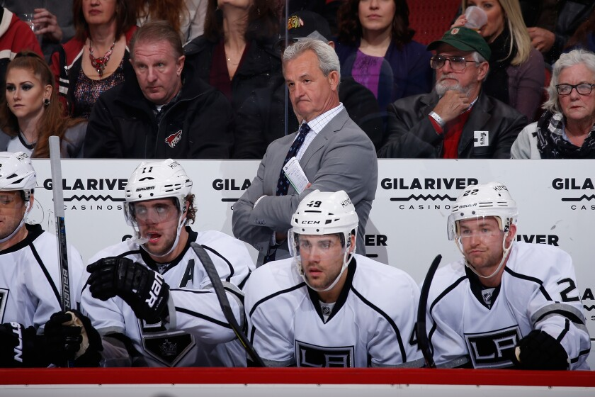 Darryl Sutter coaches the Kings during a game against the Coyotes in December 2015.
