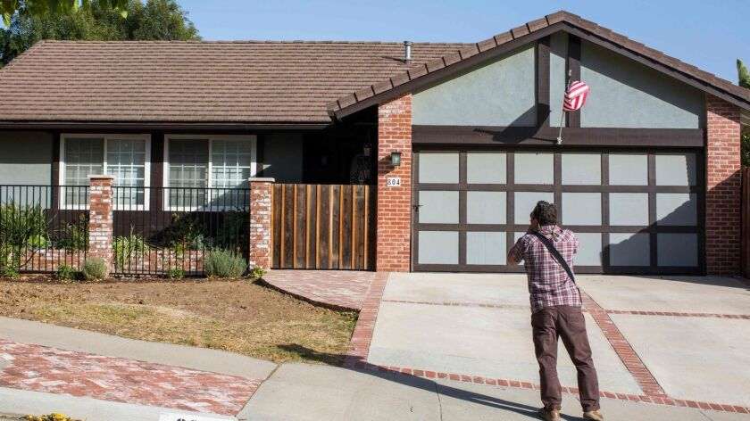 A photographer takes pictures of the home of nightclub shooter Ian David Long in Newbury Park.