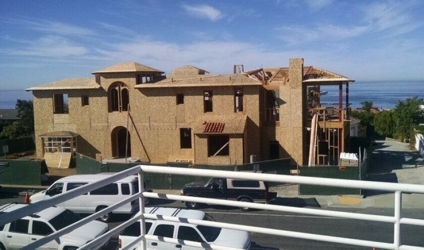Bird Rock residents are upset that this large home at 5706 Chelsea Ave. (as seen under construction in 2014), and others like it, are exempt from community review and the requirement for a coastal development permit. One of the items on LJCPA's wish list for city funding in fiscal year 2015-2016 is