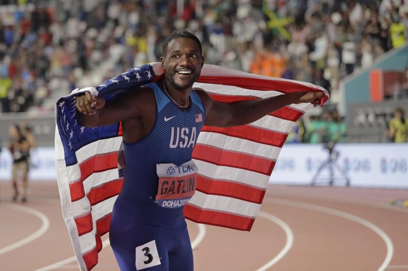 Justin Gatlin celebrates winning the silver medal in the men's 100-meter final.