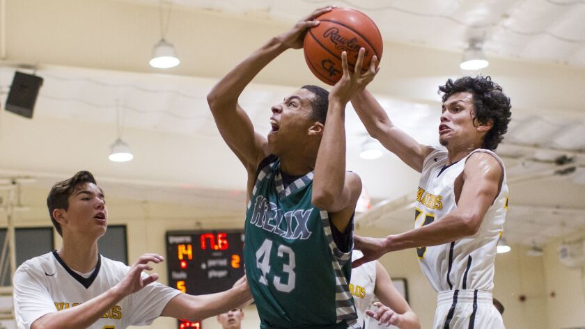 Helix's Maurice Holmes drives to the net under coverage from El Capitan defenders.