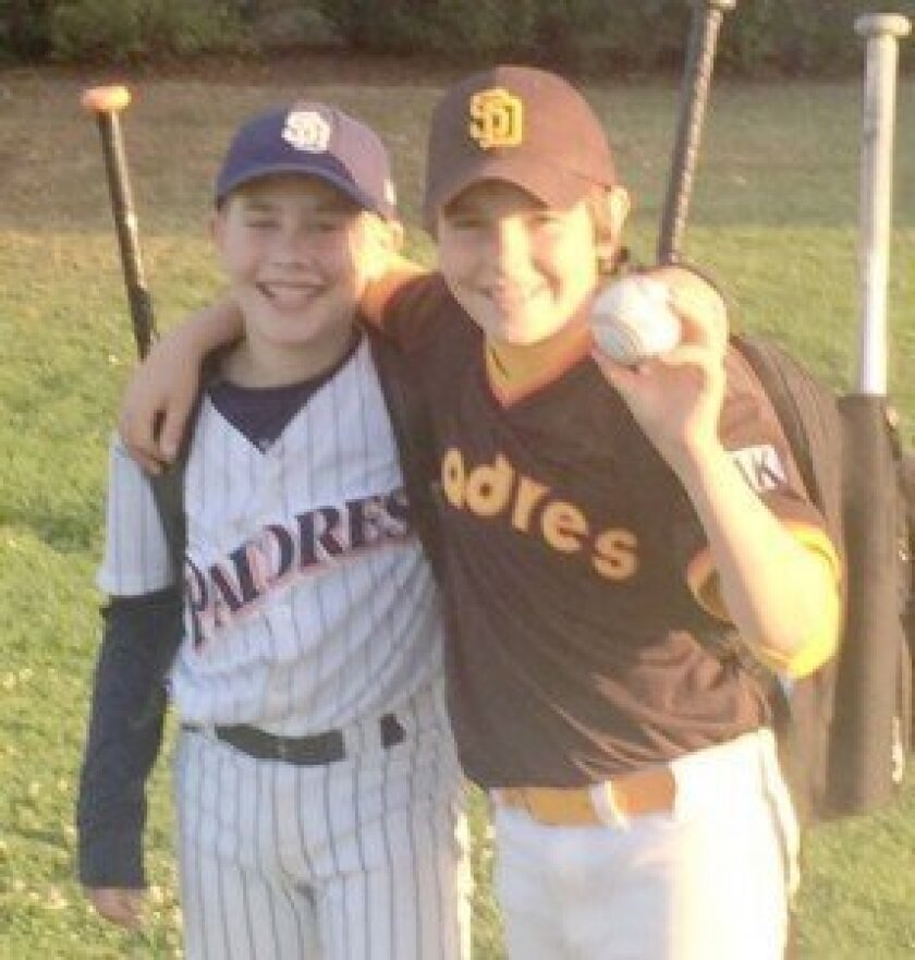 La Jolla Youth Baseball players Jake Bold and Nathan Latimer exchange congratulations following their Mustang game. Jake's team Qualcomm may have defeated Nathan's team RAK, but the highlight of the day was Nathan's home run over the left field fence. It was the first of the season at LJYB.