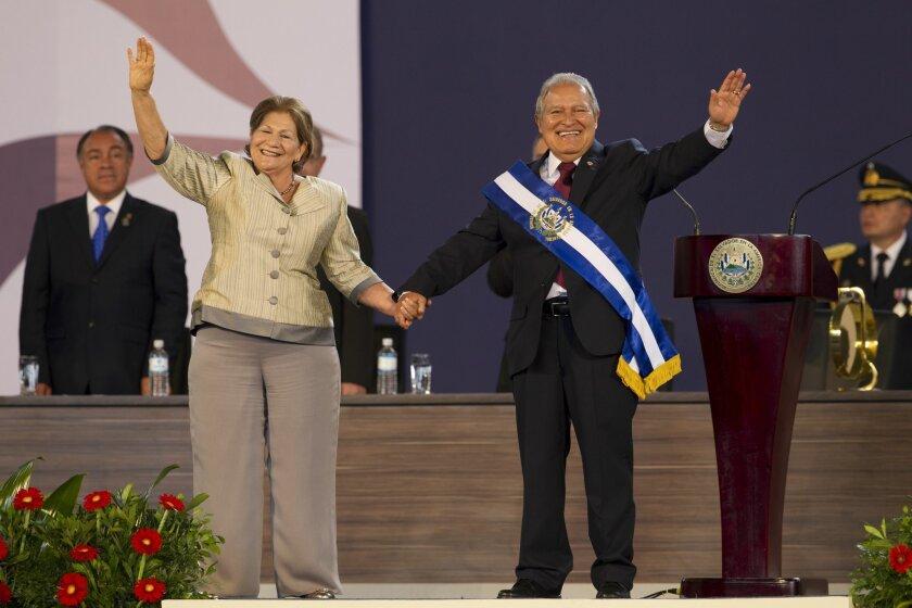 El Salvador's incoming President, Salvador Sanchez Ceren, right, and his wife Margarita Villalta wave during his swearing in ceremony in San Salvador, El Salvador, Sunday, June 1, 2014. (AP Photo/Moises Castillo)