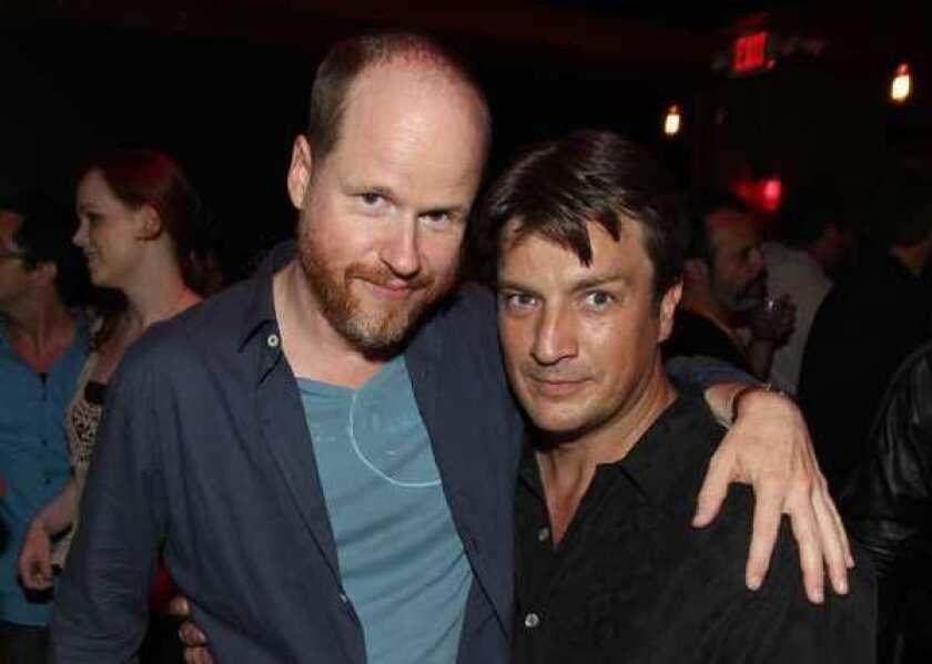 Joss Whedon, left, and Nathan Fillion at a party during Comic-Con in San Diego.