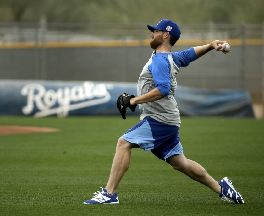 Kansas City Royals pitcher Ian Kennedy throws during spring training baseball practice Thursday, Feb. 18, 2016, in Surprise, Ariz. (AP Photo/Charlie Riedel)
