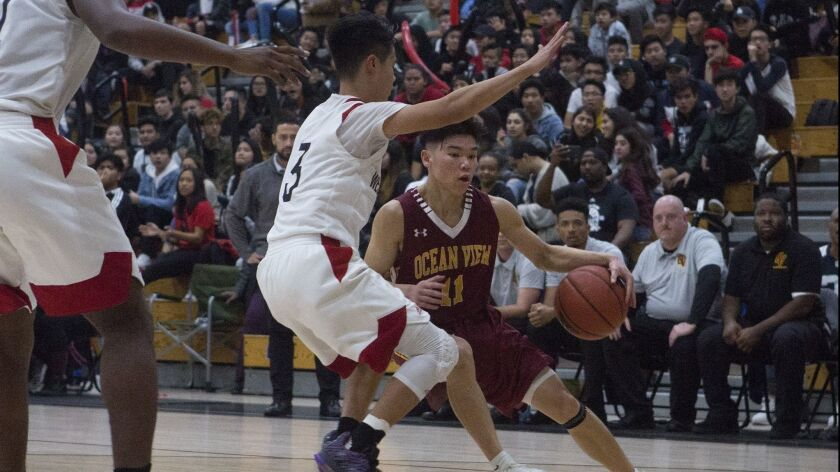 Ocean View's Carson Nguyen tries to get past Westminster's defense during a Golden West League game