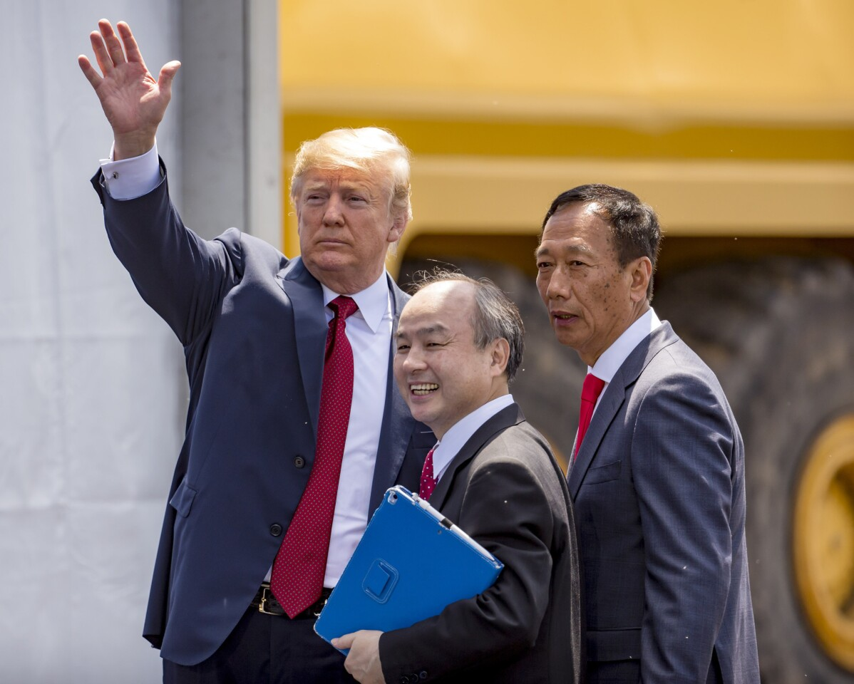 President Donald Trump leaves with SoftBank CEO Masayoshi Son and Foxconn Chairman Terry Gou, right, after a groundbreaking event for the Foxconn plant on June 28, 2018, in Mt. Pleasant, Wis.