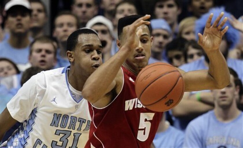 North Carolina's John Henson (31) guards Wisconsin's Ryan Evans (5) during the first half of an NCAA college basketball game in Chapel Hill, N.C., Wednesday, Nov. 30, 2011. (AP Photo/Gerry Broome)