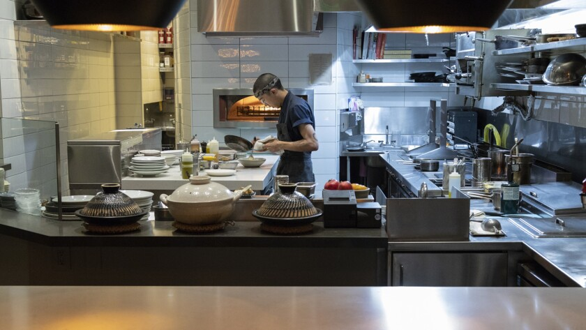 LOS ANGELES, CA - OCTOBER 17, 2018 - Counter top and kitchen at Orsa & Winston restaurant in downtow