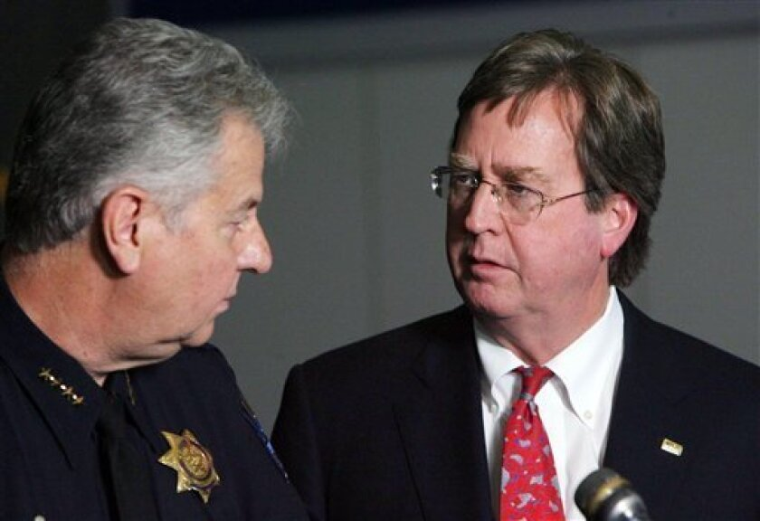 Tulsa Mayor Dewey Bartlett, right, chats with Tulsa Chief of Police Chuck Jordan during a news conference at the Tulsa Police Department, Saturday, April 7, 2012 in downtown Tulsa, Okla. Police believe the same attacker or attackers are behind a series of early-morning shootings in which three people were killed and two others were critically wounded within a three-mile span of north Tulsa. (AP Photo/Tulsa World, James Gibbard) MAGS OUT; TULSA OUT; MANDATORY CREDIT