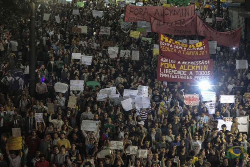 Protesters gather in Sao Paulo, Brazil, as demonstrations continued against rising bus fares and police actions.