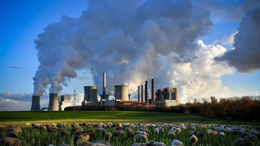 Steam rises from the brown coal-fired power plant Neurath, front center, and Niederaussem, rear left, in Germany. Between 2014 and 2016, global carbon emissions remained largely flat. In 2017, global emissions grew 1.6%. The rise in 2018 is projected to be 2.7%.