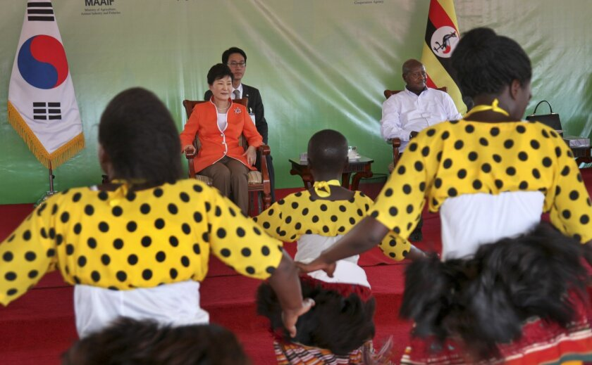 South Korea's president Park Geun-hye, center left, and Uganda's President Yoweri Museveni, center right, attend a ceremony to open the South Korea-funded National Farmers Leadership Centre at Kampiringisa, south-west of the capital Kampala, in Uganda, Monday, May 30, 2016. Uganda is cutting milita