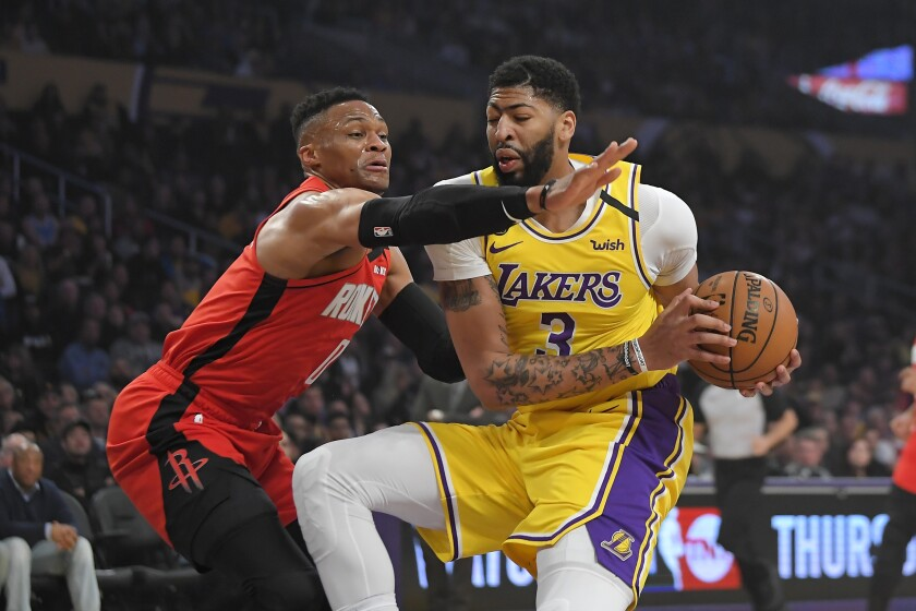 Lakers forward Antonio Davis tries to score inside against Rockets guard Russell Westbrook during a game Feb. 6, 2020.