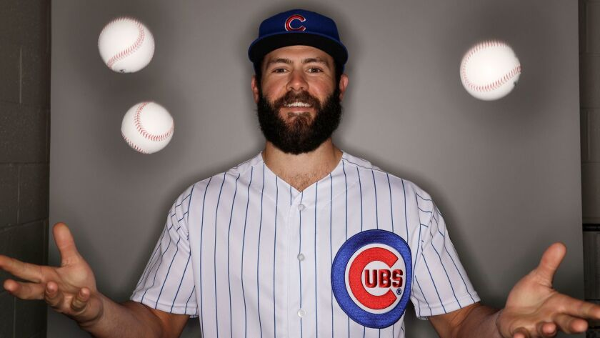 The Chicago Cubs' Jake Arrieta juggles during the team's photo day Tuesday, Feb. 21, 2017, in Mesa, Ariz.