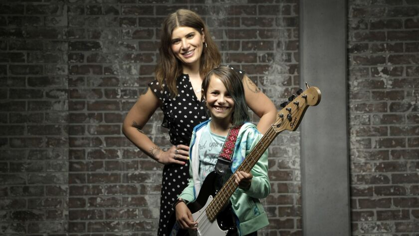 Bethany Cosentino of Best Coast, left, with 11-year-old Alia Briglia, who's learning to play bass.