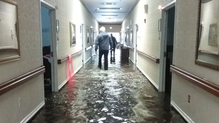 Residents were evacuated from the Cypress Glen senior care facility in Port Arthur, Texas which was inundated with water from tropical storm Harvey.