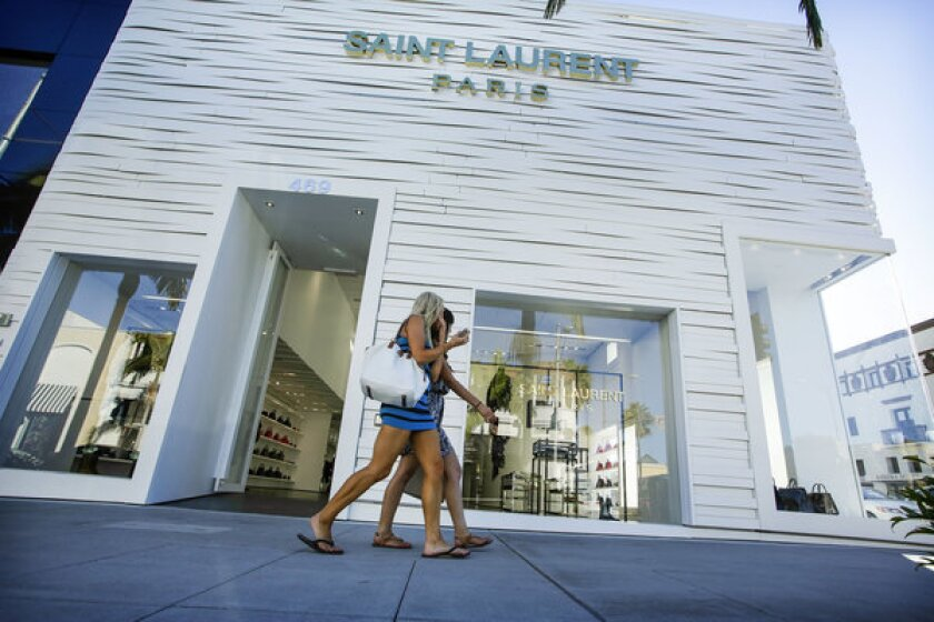 Women walk past Saint Laurent Paris in August. More than $100,000 in merchandise was stolen from the Rodeo Drive boutique, Beverly Hills police say.