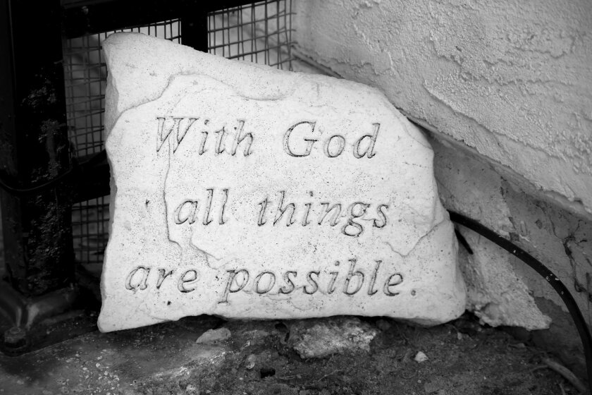 """At the entrance to the Moehlig home is a stone with the words, """"With God all things are possible"""" etched into it."""