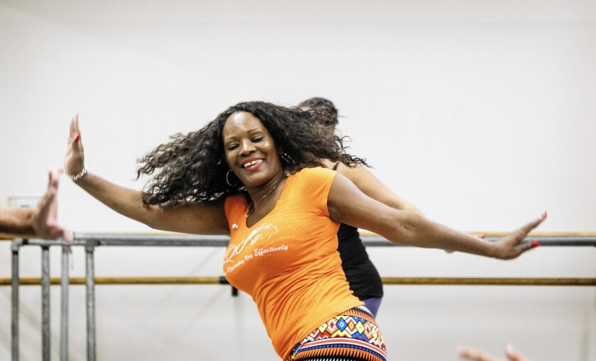 Dianne Shorte swings into action in a dance fitness class at Debbie Allen Dance Academy.