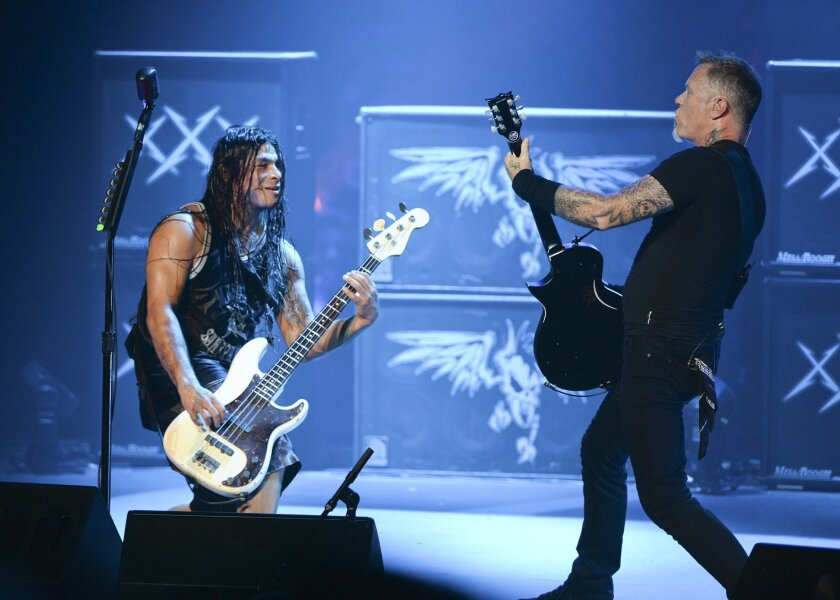 Musicians Robert Trujillo, left, and James Hetfield of Metallica perform a secret concert in celebration of 'Metallica Through The Never'at Spreckels Theatre on Friday.