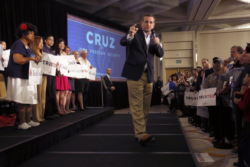 Ted Cruz takes the stage during a rally in Irvine on Monday. An enthusiastic, standing-room-only crowd showed up for the GOP presidential candidate's event.