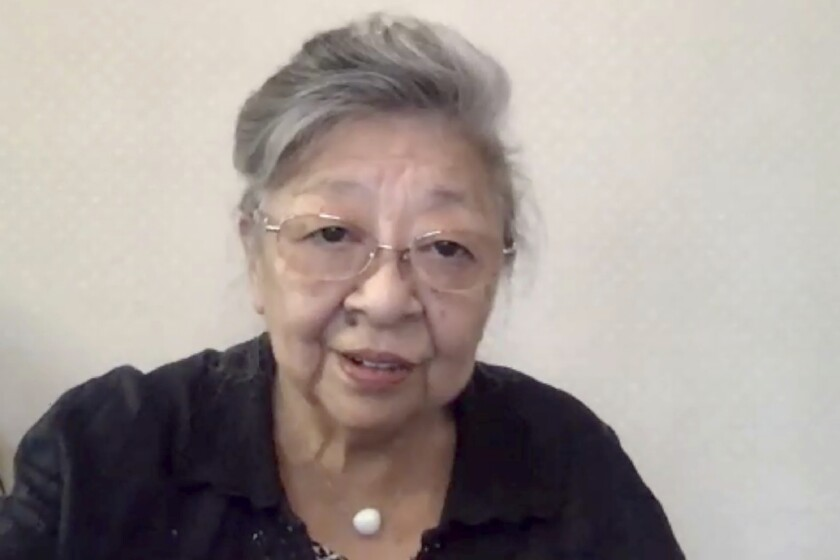 """In this image made from video, Koko Kondo speaks during an video interview from Miki city, western Japan, on July 30, 2020. Kondo was determined to find the person who dropped the atomic bomb on Hiroshima, western Japan, the person that caused the suffering and the terrible facial burns of the girls at her father's church - and then square off and punch them in the face. Ten-year-old Kondo appeared on an American TV show called """"This is Your Life"""" that was featuring her father, Rev. Kiyoshi Tanimoto, one of six survivors profiled in John Hersey's book """"Hiroshima."""" Kondo stared in hatred at another guest: Capt. Robert Lewis, co-pilot of B-29 bomber Enola Gay that dropped the bomb. (AP Photo)"""