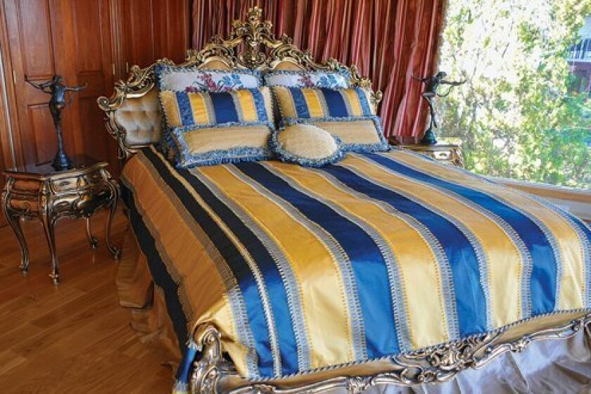 Symphony Home Décor's 'Secret in Nile' bedroom collection typifies the high-quality luxury the company has built its reputation on. The set's elegant royal blue-and-gold-stripe reversible duvet is well suited to a European palace. Courtesy Photo