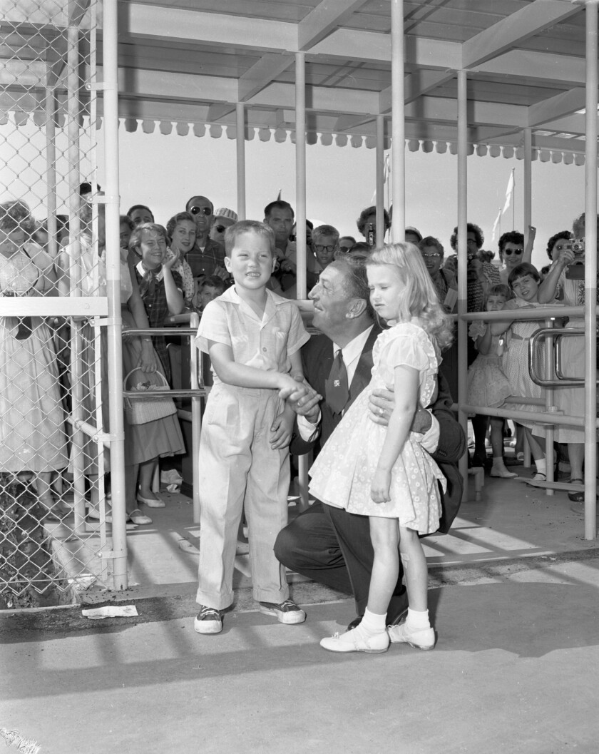 July 18, 1955: Walt Disney with Michael Schwartner, 7, left, and Christine Vess, 5, two of the first