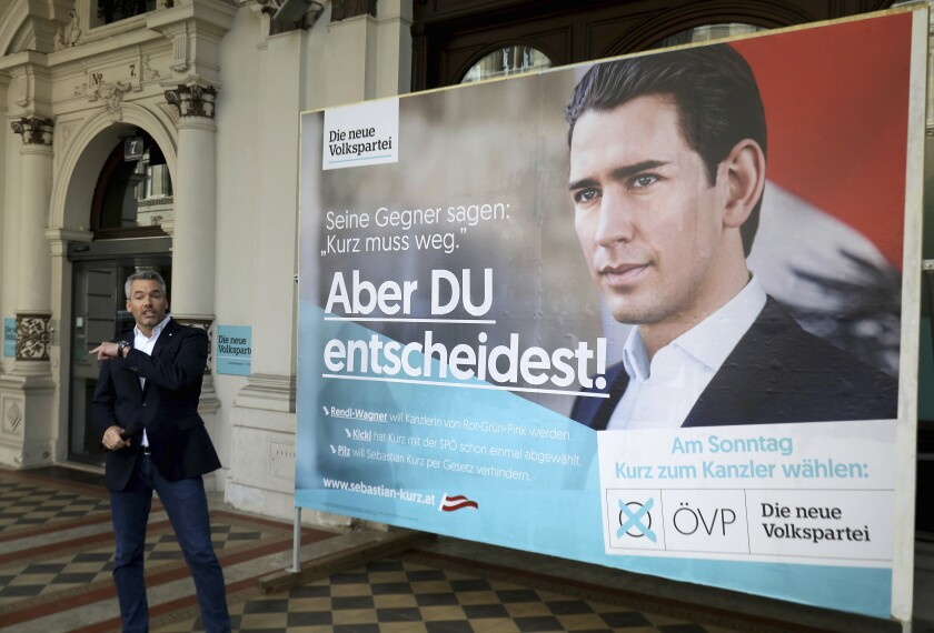 Karl Nehammer Secretary General of Austrian People's Party, OEVP, presents a poster of the conservative Austrian People's Party, OEVP, with former Austrian chancellor Sebastian Kurz for the upcoming Austrian national elections in Vienna, Austria, Tuesday, Sept. 24, 2019. The Austrian elections will held on Sunday, Sept. 29, 2019. The poster's main slogan reads: 'His opponents say Kurz has to go - But you decide'. (AP Photo/Ronald Zak)